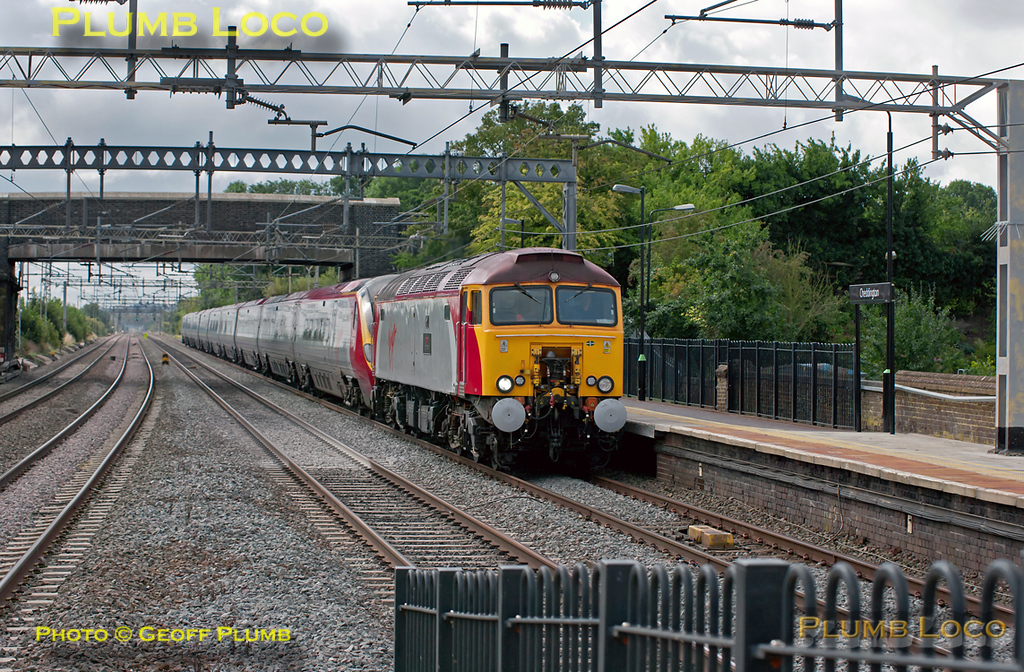 "This should have been the third of the morning drags from Euston but in the event it was the second... 57309 ""Brains"" is dragging Pendolino 390 048, 1G04, the 09:10 from Euston to Wolverhampton, which the 57 powered all the way. It is approaching Cheddington fairly fast at 10:44, somewhat late, and starting to slow to cross over at Ledburn Junction onto the down slow line. Sunday 28th August 2011. Digital Image No. GMPI10162."