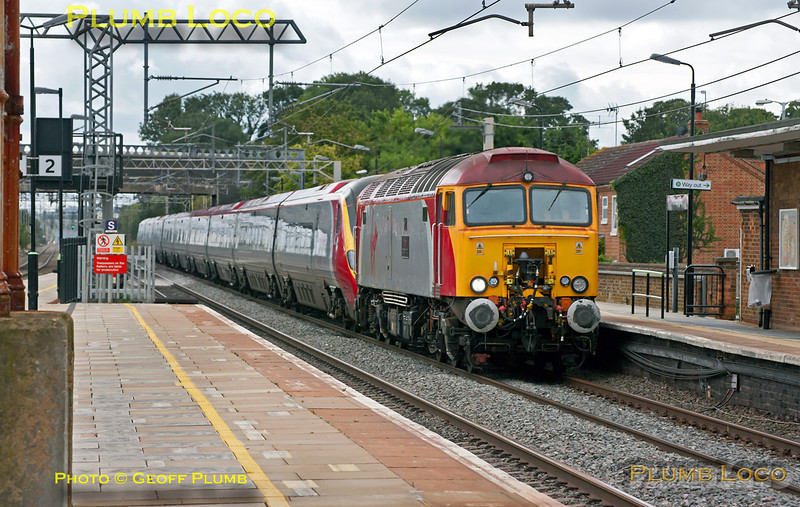 """The third of the three drags on Sunday morning was 1H03, the 09:05 from Euston to Manchester with 57304 """"Gordon Tracy"""" dragging 390 051 through Cheddington at 10:55, running somewhat late. This should have been the second of the drags but as the 57 was working only as far as Milton Keynes Central it could have held up the train behind if this plan was adhered to. Sunday 28th August 2011. Digital Image No. GMPI10169."""