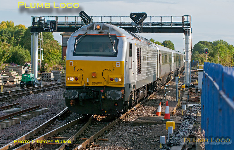 """The second set of Chiltern silver coaches was due to receive the Mainline branding over the weekend of 6th & 7th August 2011, but due to a loco failure and other events this turned out not to be possible. This working is 1H08, 06:53 from Banbury to Marylebone, normally worked by the Chiltern """"Hybrid"""" set AL02, but here formed of the set that normally works from Moor Street. Driver Ed Pearce gives a wave to the camera as the train arrives behind 67015 """"David J. Lloyd"""" for the station stop at Princes Risborough at 07:28, due to depart at 07:30. Monday 8th August 2011. The train did depart on time at 07:30, but the engine shut down at Saunderton due to loss of coolant via a faulty heat exchanger, the train then managing to coast downhill all the way to High Wycombe where passengers could detrain and other trains get round the failed train, though with inevitable delays... Digital Image No. GMPI9986."""