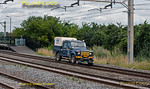 On Sunday 7th August 2011 there was a possession in place on the slow lines through Cheddington on the WCML, so when strange lights appeared in the distance by Ledburn Junction it was something of a mystery as to what was approaching - as it passed through the station eventually revealing itself as a rail-mounted Landrover Defender! Quite what the purpose of this was is none too clear! 10:51, Sunday 7th August 2011. Digital Image No. GMPI9952.