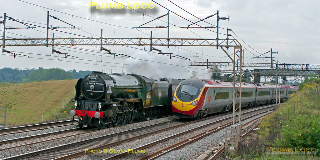 "A close run thing! A Virgin Pendolino is rushing south and just clears in time to see 60163 ""Tornado"" northbound near Old Linslade, with 1Z88, ""The Cathedrals Express"" from Euston to Worcester and return. This was running several minutes early at 08:52 on Saturday 6th August 2011. Digital Image No. GMPI9945."