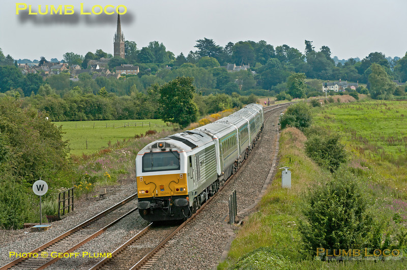 """On Saturday 11th August 2012, Chiltern ran some of its services using LHCS vice 168 units, in connection with events at Wembley. Here 1G38, the 14:00 from Marylebone to Birmingham Snow Hill, is passing King's Sutton at 15:05 with 67012 """"A Shropshire Lad"""" leading and 82302 on the rear."""