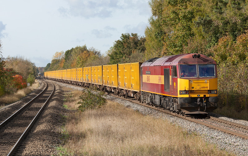 In beautiful, but cold autumn sunshine, 60045 'The Permanent Way Institution' approaches Denham station with the 6A58 10.14 Calvert-Northolt sidings empty bin liner.30.10.12