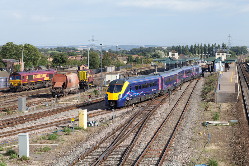 180102 leaves a sunny Didcot Parkway and heads towards Oxford with an afternoon service from Paddington.