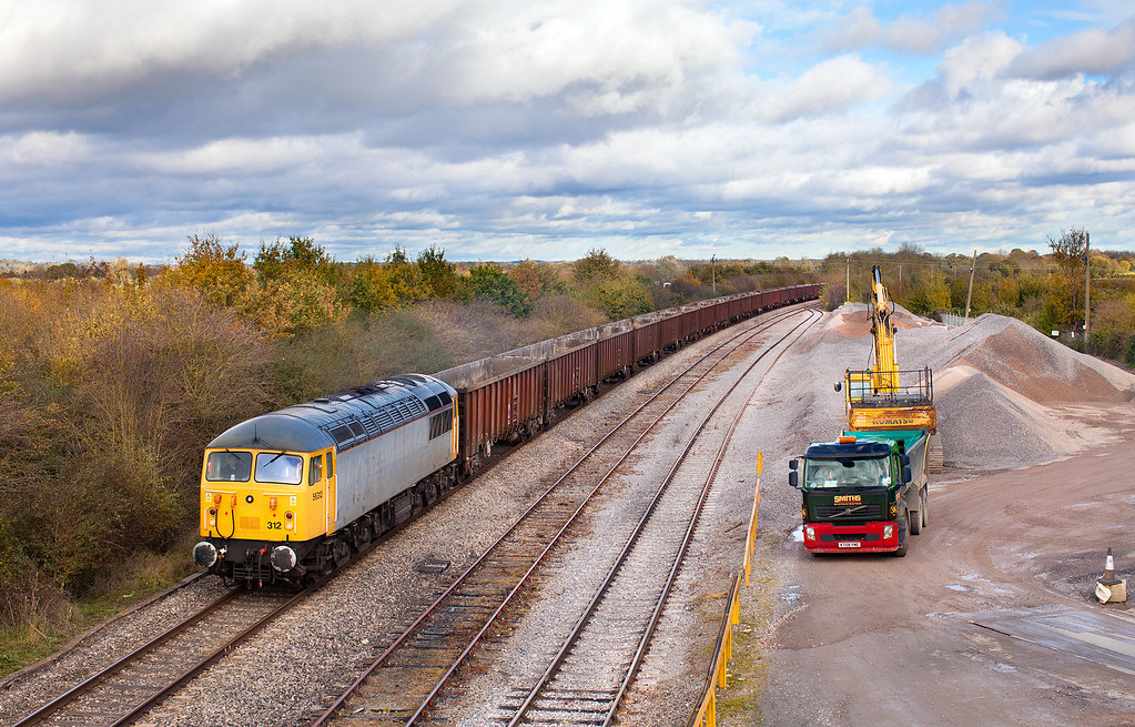 Unbroken sunshine for 30 minutes and then two minutes of cloud just as the 'grid' appears. 56312 passes Banbury Road ARC stone terminal with the 6Z91 10.55 Calvert-Didcot Power station empty fly-ash wagons.