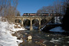 The southbound BFPO (Bellows Falls to Portland) OMYA unit train crosses the 1846 Stone Viaduct in Bernardson, MA.