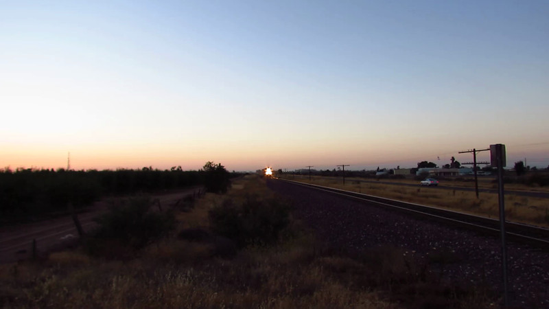 Three BNSF locomotives flying by like a bat outta hell at Modesto, California on a summer (7-23-12) evening at twilight.