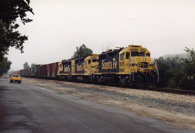 Two GP35's and a GP30 are in command of the Pasadena Local on what's left of the old Second Sub. Claremont, CA, July 2002.
