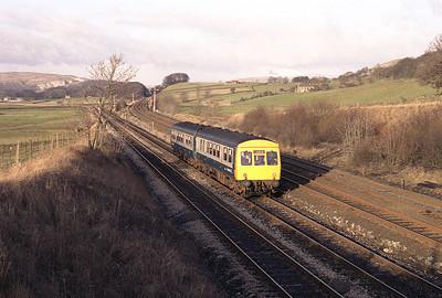 Met Cam class 111 DMUs E51550+E51558 approach Settle Junction with the 13.18 Lancaster-Leeds 8/1/84.