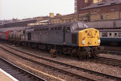 40028 hauls a westbound freight through Manchester Victoria 20/7/84.
