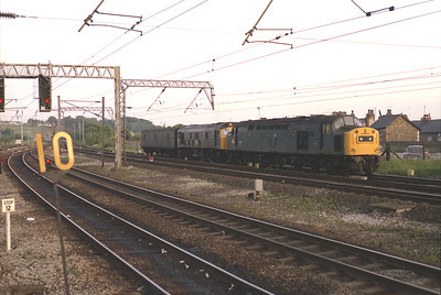 An unidentified 40 and 25 are parked at Lancaster during summer 1984.