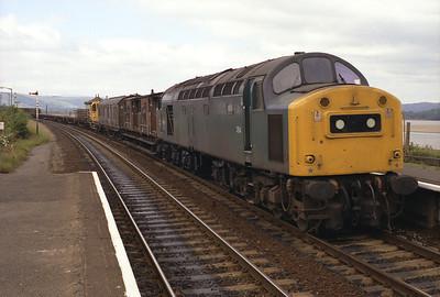 40194 heads a Sunday engineer's train through Arnside 1/7/84.