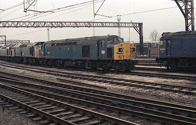 Photographed from a passing train, a rather battered 40126 stands at Crewe early in 1984.