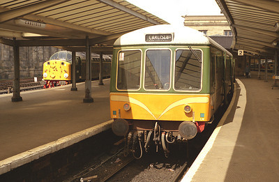 Two of Kingmoor's green pets stand in carlisle station in June 1987. Class 108 M53964+M54247 on a Whitehaven service and D200/40122 on a Leeds service.