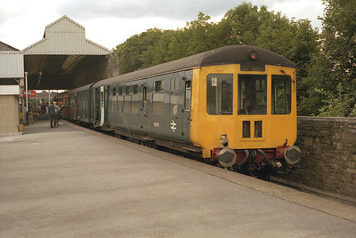 """Mobile Museum"" 2 car DMU formed of Gloucester class 100 M53355 and Cravens class 105 M53812 stands at Oxenholme together with a class 104 set, 23/8/86."