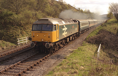 """47638 """"County of Kent"""" hauls a northbound diverted cross country train through Garsdale 3/5/87."""