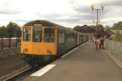 A class 104 DMU waits to leave Windermere with the 16.20 to Oxenholme 23/8/86.