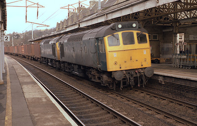 25903+25904 pass Oxenholme with rock salt containers 28/2/87.