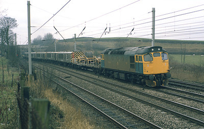 27052 stands south of Oxenholme with the wiring train on Sunday 25/1/87.