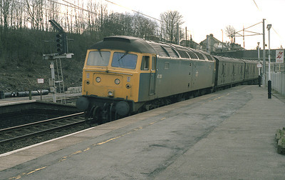 Due to problems with the overheads on 28/2/87, northbound trains had to be diesel hauled.  No Heat 47381 arrives in Oxenholne with 1S74 the Euston-Stranraer complete with motorail vans.