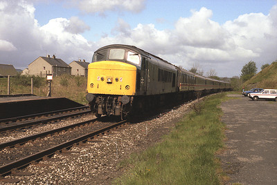 Very unusually 45124 was used to haul a train of mk3s on 2/5/87.  The diverted 07.10 Glasgow-Euston passes Long Preston.