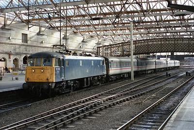 An unusually short 06.57 Coventry-Edinburgh waits in Carlisle Citadel hauled by 81019 6/10/88.