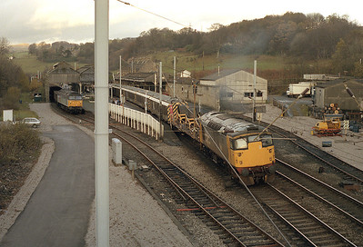 Another grim winter Sunday sees plenty of activity at Oxenholme.  26034 arrives with the electrification train whilst 47354 stands in the Windermere branch platform with a spoil train 13/11/88.