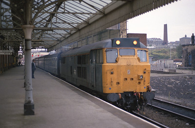31414 waits to depart Blackburn with the 18.05 to Manchester Victoria vice DMU 3/10/88.