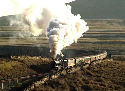 48151 accelerates away from Ribblehead viaduct with a northbound charter including an Ethel class 25 for heating 26/11/88