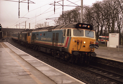 50034+50008 pass Oxenholme with a railtour 30/1/88.