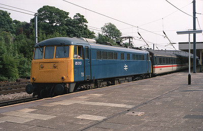 The summer Saturday 14.05 Blackpool North-Glasgow/Edinburgh pauses at Lancaster 25/6/88, hauled by 85013.