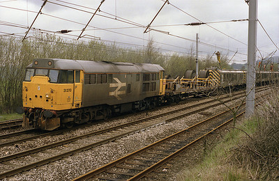 31270 stands south of Oxenholme with the overhead wiring maintentance train 24/4/88.