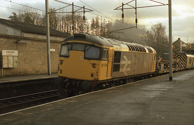 After running round in the down loop, 26034 departs Oxenholme for Upperby with the overhead wiring train Sunday 13/11/88.