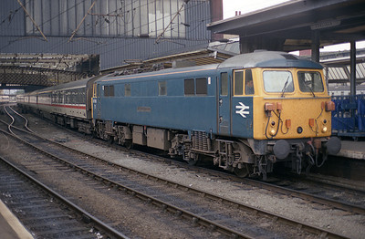 """87101 """"Stephenson"""" stands in Carlisle with the 07.20 Euston-Glasgow 3/10/88."""