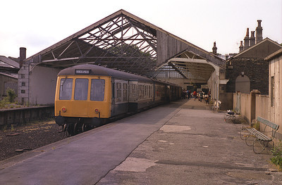 A pair of class 108 DMUs stand at Windermere station having worked the 15.00 from Lancaster 3/7/83.  Today Booths supermarket occupies the site of the old train shed.