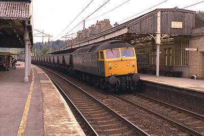 47190 passes Oxenholme with a loaded MGR coal train, probably diverted from the Cumbria Coast, 6/7/83.