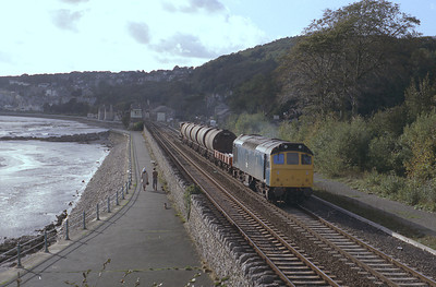 25201 works an up freight through Grange over sands 7/10/83.
