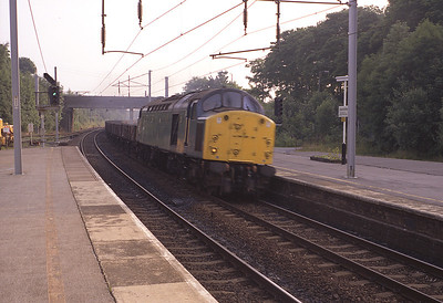 40099 passes Oxenholme with empty wagons 14/7/83.