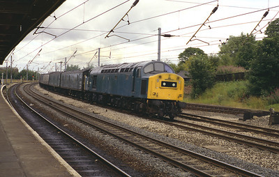 40196 rushes through Lancaster with a van train 4/8/83.