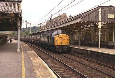 """40012 """"Aureol"""" passes Oxenholme with a train of chemical tanks 6/7/83."""