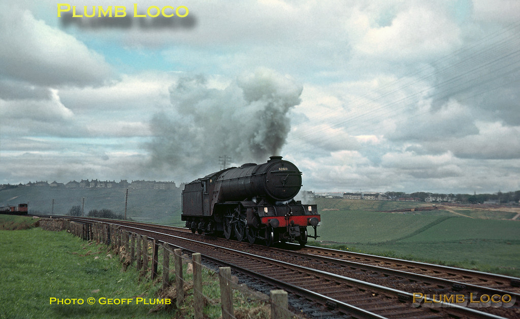 From the Geoff Plumb Collection of original slides. Gresley LNER V2 class 2-6-2 No. 60919 is working light engine southwards from Aberdeen, climbing to Nigg Bay on the East Coast. Quite why it was running light engine I have no idea... Friday 15th May 1964. Photo by Mike Burnett.