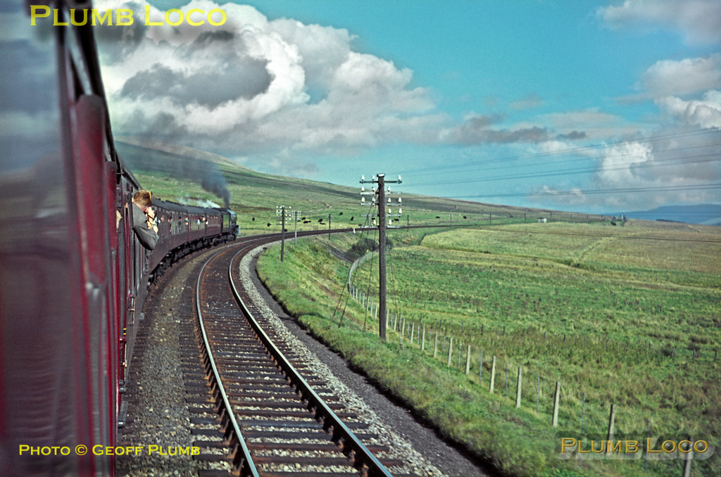 "Seen from the train, A4 4-6-2 No. 60007 ""Sir Nigel Gresley"" is blazing away on the climb to Whitrope summit during its record run over the Waveley route to Hawick, en route from Carlisle to Edinburgh with the RCTS ""Scottish Lowlander Railtour"" on Saturday 26th September 1964. Slide No. 1069."