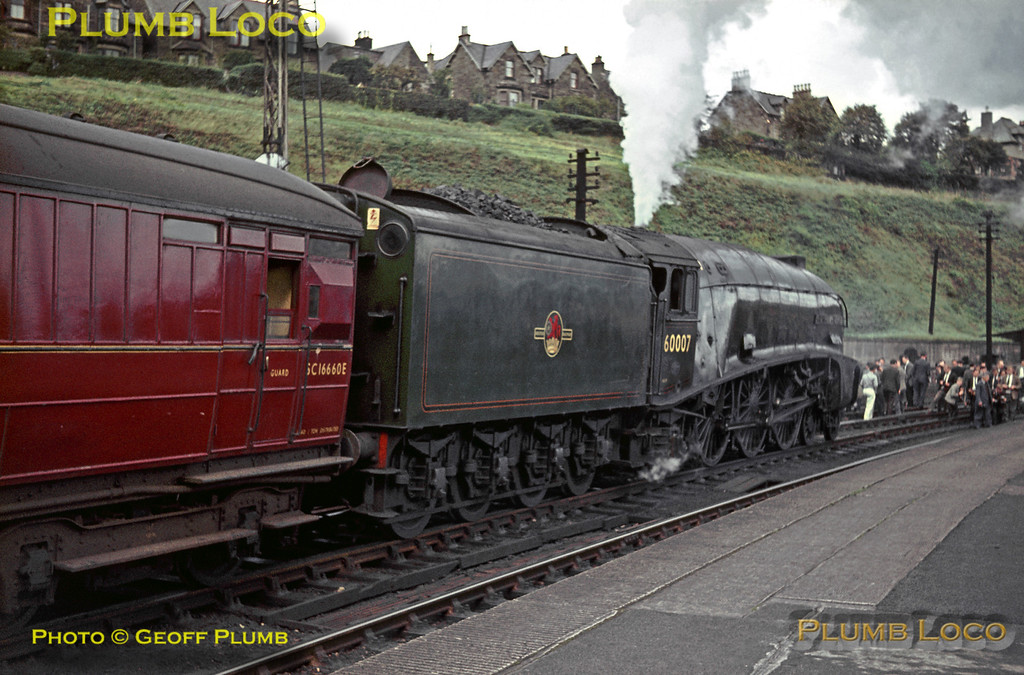 """LNER A4 class 4-6-2 No. 60007 has stopped at Hawick station on the Waverley route from Carlisle to Edinburgh with the RCTS """"Scottish Lowlander Railtour"""" on Saturday 26th September 1964. It had taken over from 46256 """"Sir William A. Stanier, F.R.S."""" at Carlisle and then put in an amazing performance over the Waverley line after having to reverse at Port Carlisle Branch Junction after being mistakenly put on the main line towards Glasgow! Slide No. 1071."""