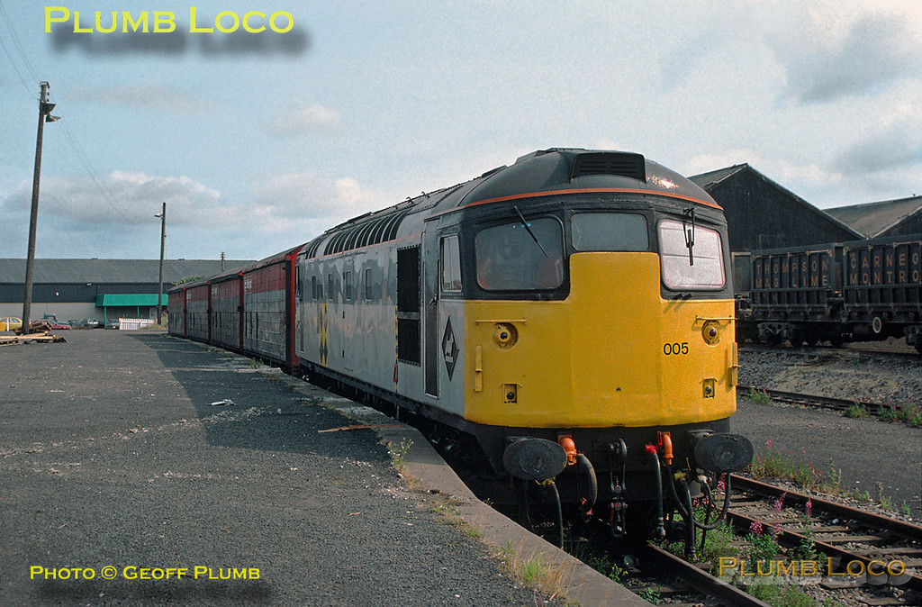 Class 26/0 No. 26005 shunts railfreight vans in the yard alongside Montrose station, much of this traffic being for the fertiliser depot. Friday 28th July 1989. Slide No. 20240.