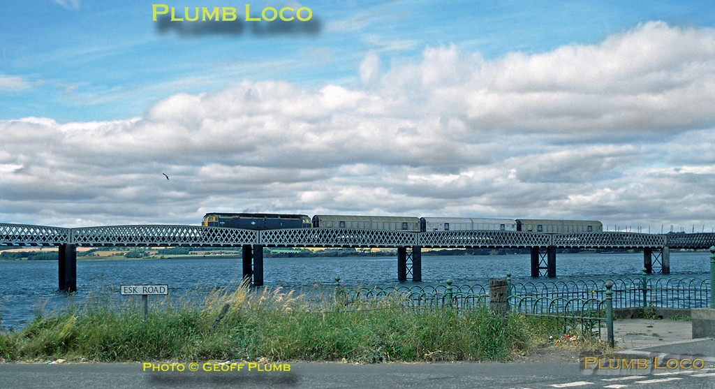 47008 crosses the viaduct over the Montrose Basin, almost at high tide, with a southbound freight train, 14:47, Monday 17th July 1989. Slide No. 20120.
