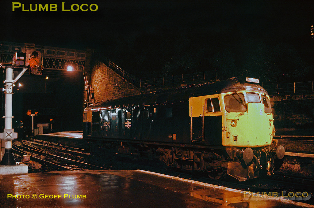 Class 26/1 No. 26042 awaits the signal at Glasgow Queen Street station to return light engine up Cowlairs bank to Eastfield depot, Thursday 9th November 1989. Slide No. 20496.