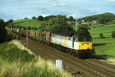 47144 hauls a timber train past Sedgwick on 13/8/93.