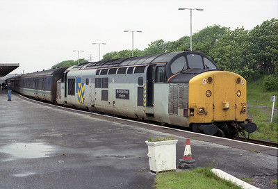 "37503 ""British Steel Shelton"" stands at Barrow with the 13.35 to Manchester Vic on bank holiday Monday 31/5/93."