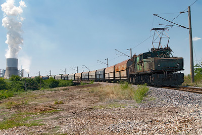 A LEW EL2 No. 112 pushes opencast mined coal towards Iztok 1 power station near Galabovo on the Marista Iztok Energy Complex. Wednesday 6th July 2016. The complex is the largest energy site in South Eastern Europe.