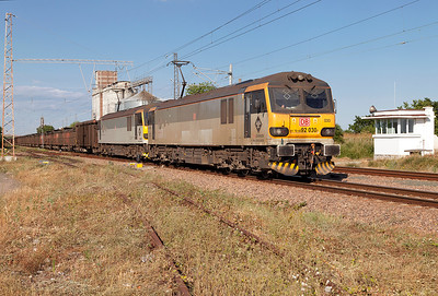 92030 'Ashford' & 92027 'George Elliot' pass the level crossing at Tserkovski west of Karnobat with loaded copper ore wagons for Pirdop. Tuesday 5th July 2016.